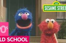 Sesame Street: Grover Demonstrates Next to A Mailbox